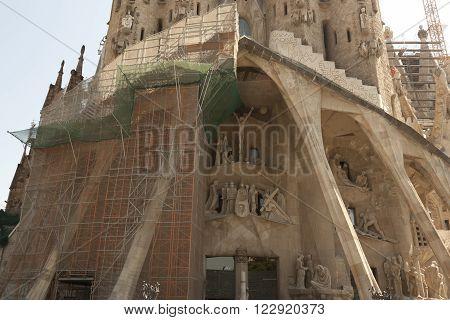 BARCELONA, SPAIN - JULY 12, 2013: Temple Expiatori de la Sagrada Familia (fragment) - Roman Catholic church in Barcelona, designed by architect Antonio Gaudi. Construction began in 1882 and continues today.