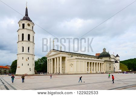 VILNIUS LITHUANIA - JULY 10 2015: Unidentified people are on the Cathedral Square near Cathedral of St. Stanislaus and St. Vladislav bell tower chapel of St. Casimir