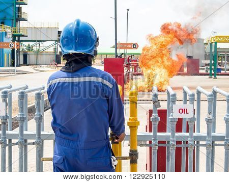 Firefighter, fire fighter,  firemen, fireman, ignite fire by discharge oil through pipeline for preparing fire during conflagration preventive extinguisher training, Safety concept.