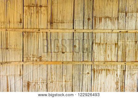 Native style bamboo wall in a rustic wooden house or a cottage found mostly in the north and northeast Thailand.