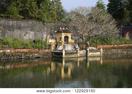 Buddhist altar in the Imperial forbidden city on Ngoc Dich lake. Hue, Vietnam