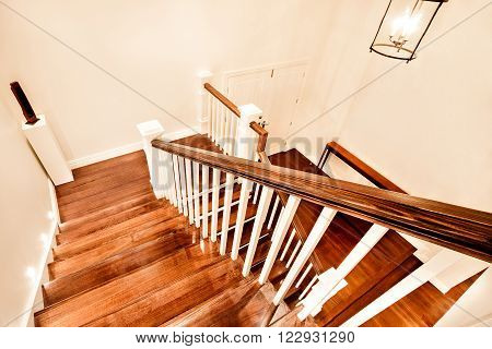 View Of Glossy Wooden Stairs From Top Showing The Closed Door