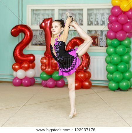 Elegant Girl Doing Crafty Trick On Gymnastics Performance