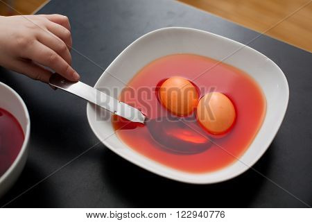 Coloring Easter Eggs In Orange Liquid