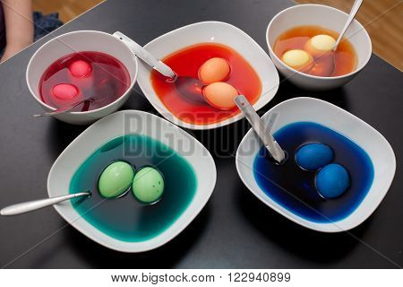Coloring Easter Eggs In Many Colors.
