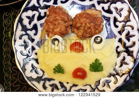 Chicken Cutlets With Mashed Potatoes On A Plate