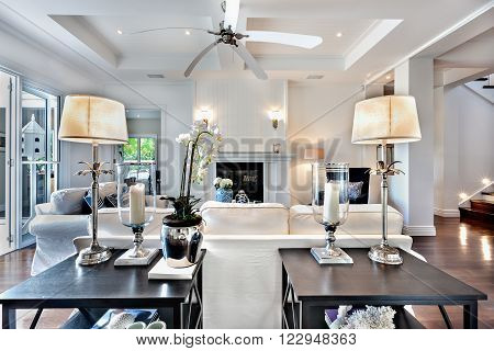 Beautiful drawing room with sofa set and two wooden table  and fan which is switched off.