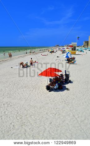 Clearwater Beach Florida USA - May 12 2015 : Tourists on the beach enjoying the sun