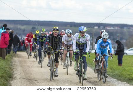Vendome France- March 7 2016:The peloton riding on a dirty road in Vendome during the first stage of Paris-Nice 2016.