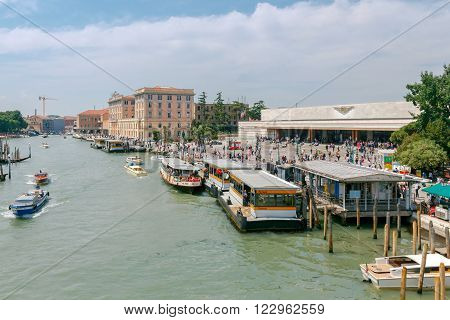 Venice, Italy - 25 May, 2015: The Central railway station of Santa Lucia and the pier for the vaporetto on the Grand Canal in Venice. Water transport is the most popular means of transportation in the city.