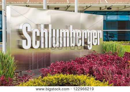 COTA, COLUMBIA - JUNE 2015: Schlumberger outdoor sign with logo in white letters on June 2015 in Cota, Columbia . The company is the word leading oilfield services company with capitalization over 100 billion dollars.