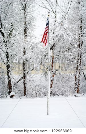 A Bright American Flag During a Snow Storm