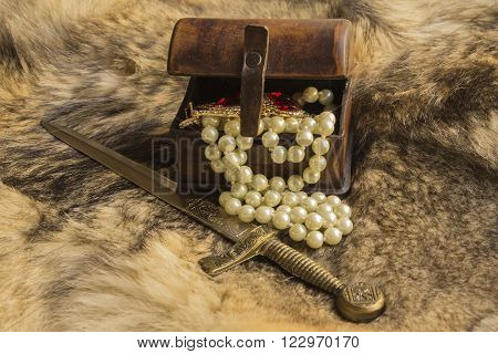 a casket and dagger with jewels on natural fur a wild Wolf