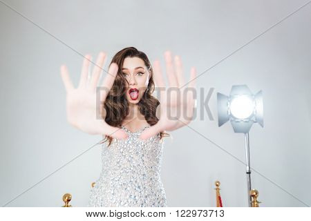 Fashion woman not willing to be photographed