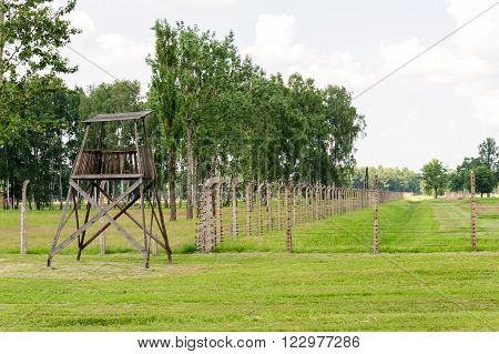 Auschwitz II - Birkenau, aspect of the electrified barbed wire fence and watch tower