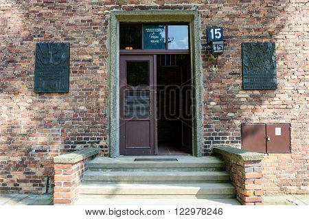 OSWIECIM, POLAND - JULY 3, 2009: Auschwitz I - Birkenau Block 15 men's camp entrance which houses an exhibit entitled Historical Introduction
