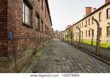 Auschwitz I - Birkenau north east perimeter with Block 1 on the left and commandant's office outside the compound on the right