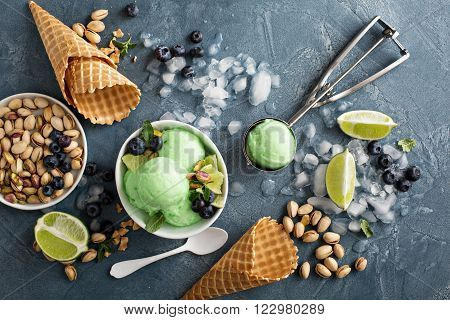 Green refreshing lime pistachio  ice cream in white bowl overhead shot