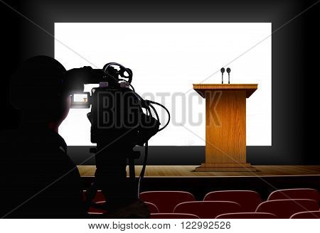 Cameraman shooting a podium with blank screen