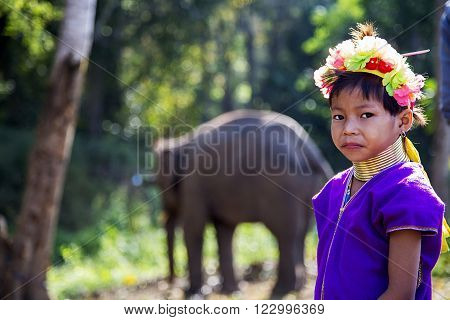 CHIANG MAI, THAILAND - FEBRUARY, 02 2016: Unidentified girl from Karen Long Neck Village near Chiang Mai Thailand. This village is a part of very popular Hill tribe tourism in Thailand.
