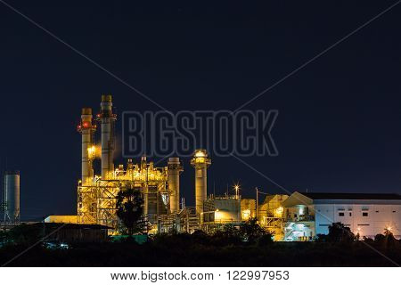 Electrical power plant (possibly gas turbine power plant) at night