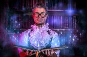 Crazy medieval scientist working in his laboratory with old manuscripts. Alchemist. Halloween. poster