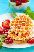 Belgian waffles with honey and berries
