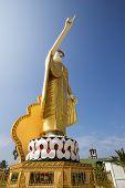 The pointing Buddha statue at Wat Jom Sak Temple in Kengtong (Kyaing tong) city, Shan State, Myanmar. poster
