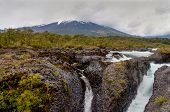 Petrohue Falls and Osorno Volcano with its snow peak in Puerto Varas in nasty weather Puerto Montt - Chile. poster