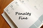 Penalty fine text concept write on notebook poster