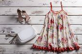 Floral sarafan and footwear. Sarafan and shoes on showcase. Woman's simple outfit for summer. Garment of light fabric. poster