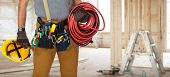 Electrician with construction tools and cable. poster