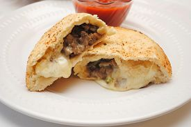 Philly Cheese Steak Calzone Served on a Plate
