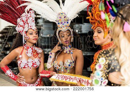 Brazilian women contesting who will be the Queen of carnival (Written in Portuguese: Rainha do Carnaval)