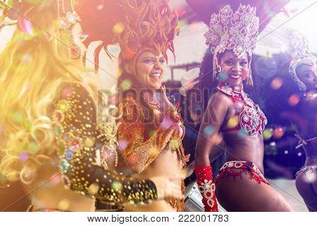 Brazilian women dancing samba music at carnival party