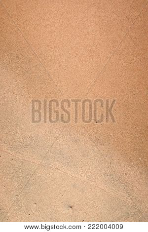 an image of a wet sand background