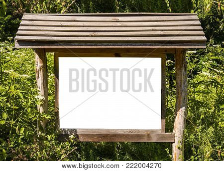 A blank white board in a forest for information ,sign for advertising blank white board in a forest for information ,sign for advertising