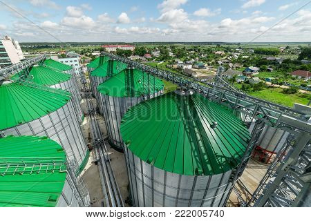 Silos of the granary. A modern warehouse of wheat and other cereals. View from above.