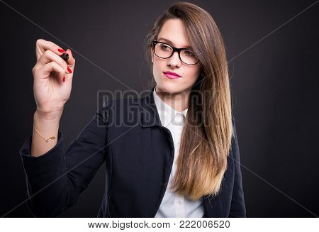 Young Businesswoman Looking At Camera And Holding Telephone.