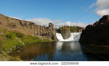 Double waterfall falling between basalt rocks in Iceland
