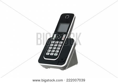 modern cordless landline dect phone with charging station isolated on white