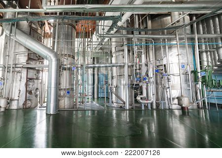 Alcohol production shop. Rectification columns with many tubes.