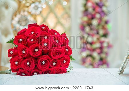 Valentines day concept. A bouquet of flowers bouquet of a red roses. Red bouquet of red roses at wedding