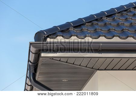 Corner of the new modern house with gutter roof and wall