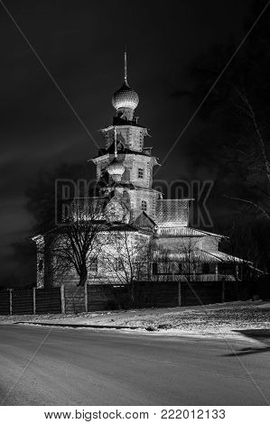 Wooden Transfiguration Church - a monument of wooden architecture of the XVIII century. Night view. Black and white photography. Suzdal. Russia. Museum of wooden architecture in Suzdal winter night.