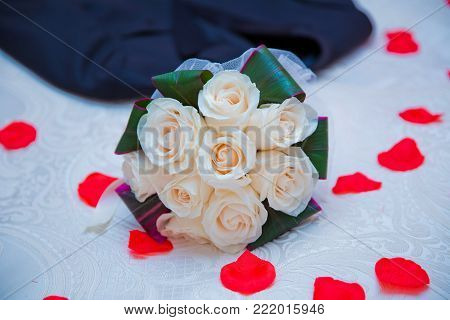 White bouquet of white roses at wedding. Valentines day concept. A bouquet of flowers bouquet of a white flowers