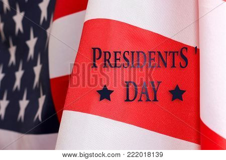 Presidents ' day background. The text of PRESIDENTS ' DAY  and the US flag.