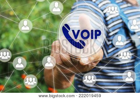 The businessman clicks the button VOIP on the touch screen