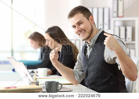 Portrait of a proud businessman pointing himself at office