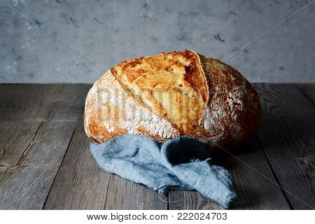 Fresh homemade bread on a gray background. Crisp. French bread.
